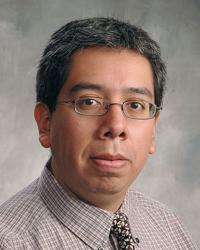 Carlos M Flores
