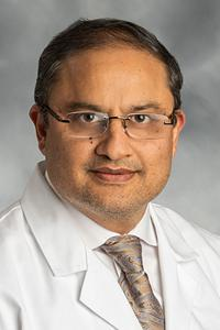 Photo of Dr. Dogra